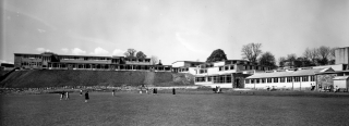 Photo: School (4) (JPG 26Kb); View of enlarged school from the river in 1950s. The dining hall with its corrugated roof was added around this time. It is still used as part of the Craft and Design Area